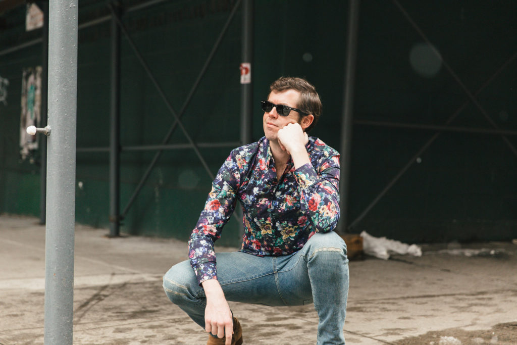 Floral Shirt Kneeling Looking to Right